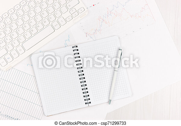 Flat lay photo of white office desk with laptop, smartphone, eyeglasses, notebook and pen with copy space background. Mockup - csp71299733