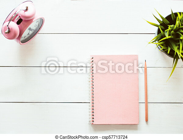 flat lay photo of workspace desk with sketchbook and pencil on copy space white background - csp57713724