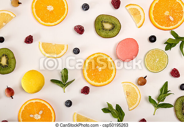 Flat lay still life with macarons, berries, mint and citrus and other fruits - csp50195263