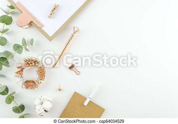 Flat lay, Top view office supplies table desk. Feminine desk workspace frame with green leaves eucalyptus, clipboard and cotton on white background. ideas, notes or plan writing concept. Hero header - csp64034529