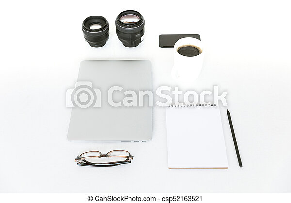 Flat lay with laptop and camera lenses - csp52163521