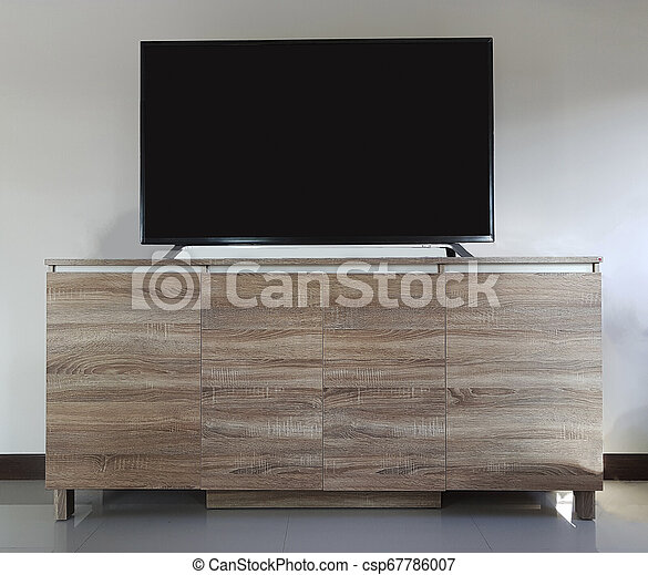 Flat screen television with cut out screen on large table isolated on white. - csp67786007