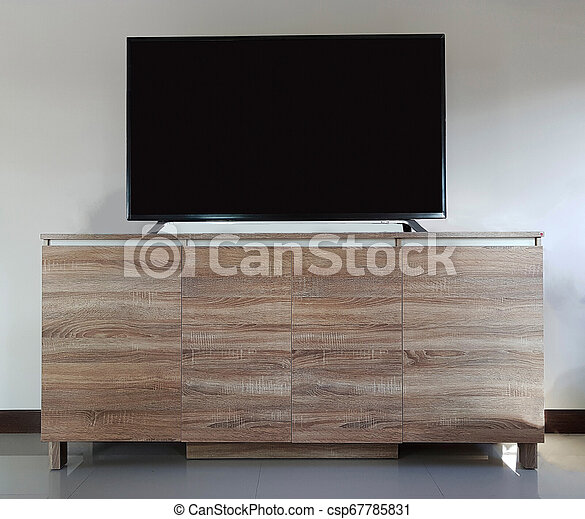 Flat screen television with cut out screen on large table isolated on white. - csp67785831