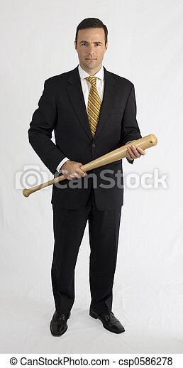 Mann im Anzug mit Baseballschläger - csp0586278
