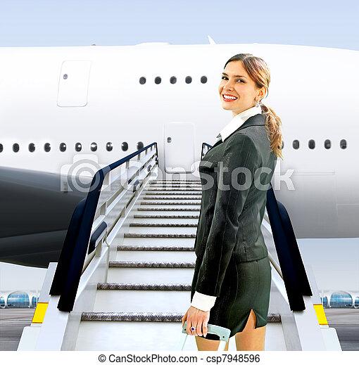 flight attendant near moving ramp - csp7948596