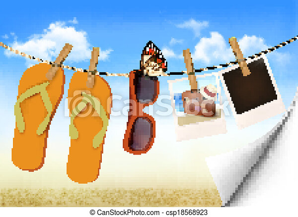 Flip flops, sunglasses and photo cards hanging on a rope ...