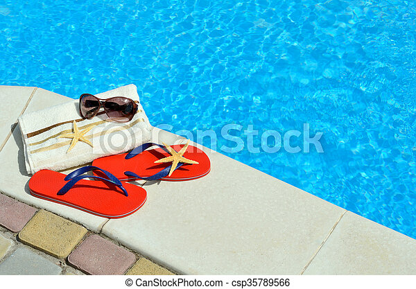 03ca5c03 Flip-flops, sunglasses, towel, starfish on the swimming pool.