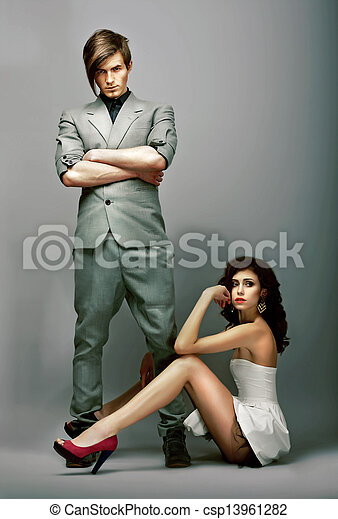 Flirt. Lifestyle. Fashionable Man with Crossed Arms and Gorgeous Woman - csp13961282