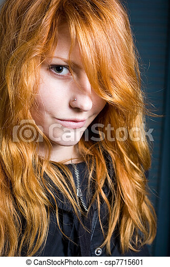 Flirty, moody portrait of a beautiful young redhead girl. - csp7715601