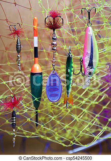 float and baits on a fishing net background - csp54245500