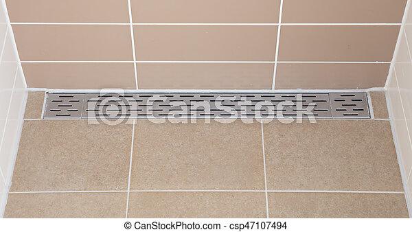 Floor drain in a modern shower - csp47107494
