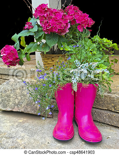 Floral Design Boots and Flowers - csp48641903
