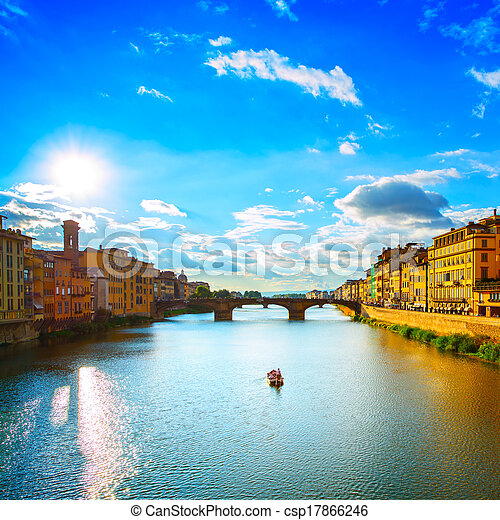 Florence or Firenze, Ponte Santa Trinita medieval Bridge landmark on Arno river and a boat, sunset landscape. Tuscany, Italy. - csp17866246