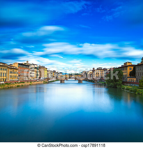 Florence or Firenze, Santa Trinita and Old Bridge landmark on Arno river, sunset landscape with reflection. Tuscany, Italy. Long exposure. - csp17891118