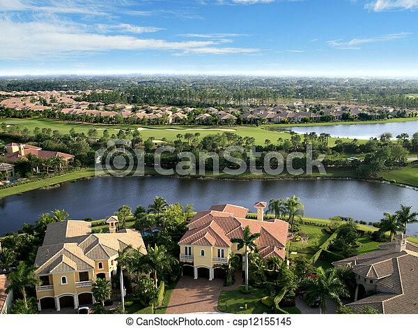 Florida Neighborhood Flyover Aerial - csp12155145