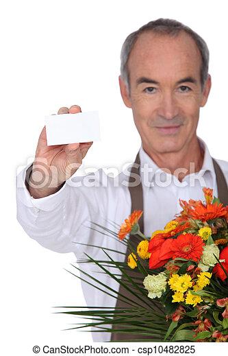 Florist showing business card - csp10482825
