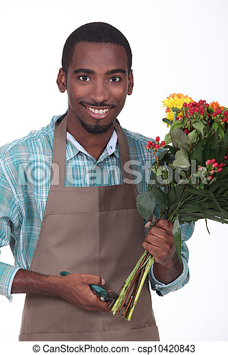 florist with bouquet of flowers on white background - csp10420843