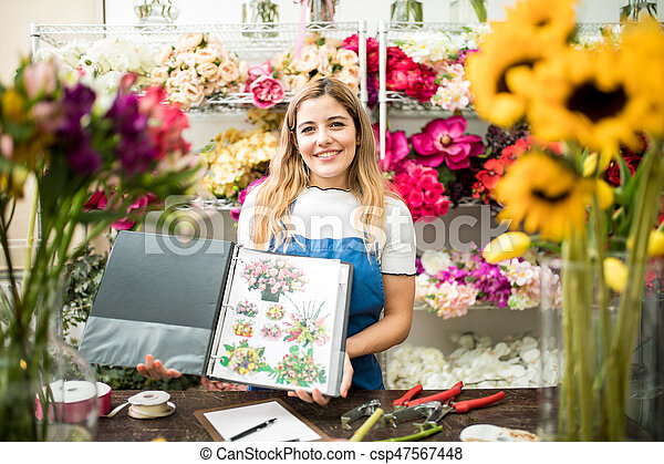 Floristry Specialist Showing Her Catalogue