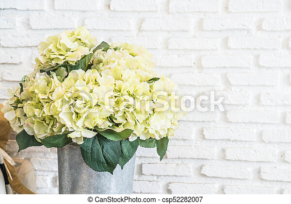 flower in pot with white brick wall background - csp52282007