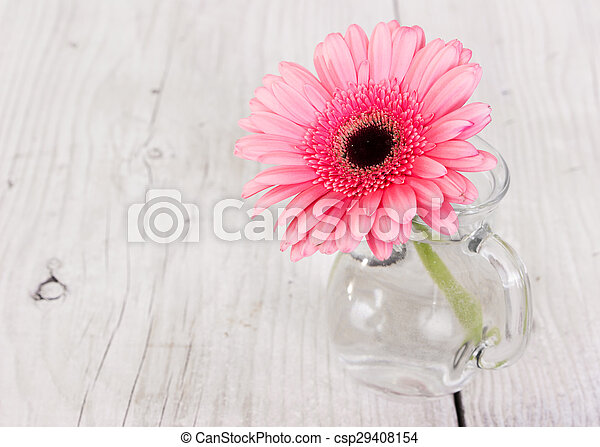 Flower Pink Gerbera In A Glass Vase On A Wooden Background