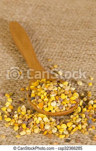 flower pollen on a wooden spoon - csp32366285