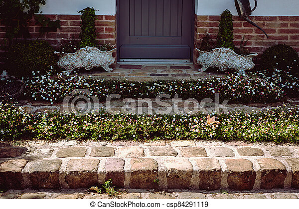 Flower stone staircase in front of the entrance door - csp84291119