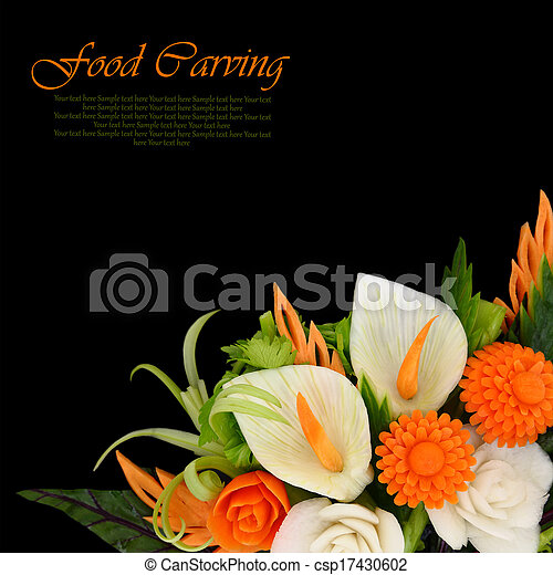 Flowers carved from fruits and vegetables on black background - csp17430602