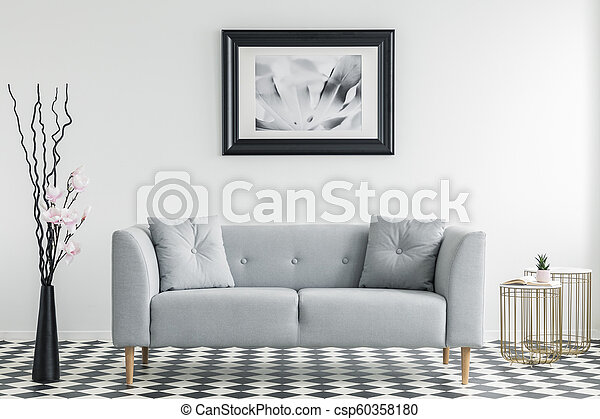 Flowers Next To Grey Sofa With Cushions In Minimal Living Room Interior With Poster Real Photo
