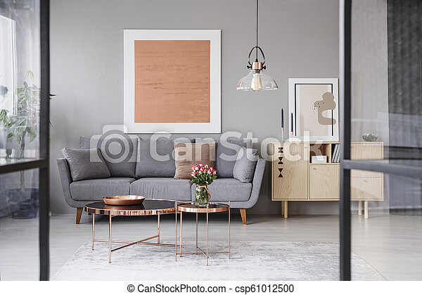 Marvelous Flowers On Copper Table In Front Of Grey Couch In Living Room Interior With Rose Gold Poster Real Photo Lamtechconsult Wood Chair Design Ideas Lamtechconsultcom