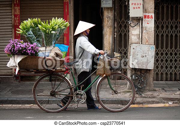 Flowers street vendor at Hanoi city, Vietnam. - csp23770541