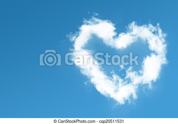 Fluffy heart cloud on blue sky - csp20511531