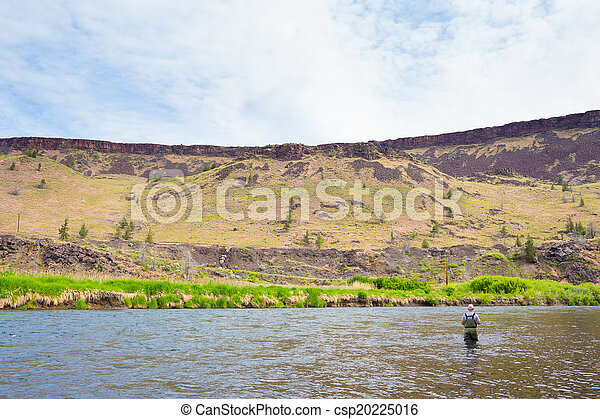 Fly Fisherman Casting on the Deschutes River