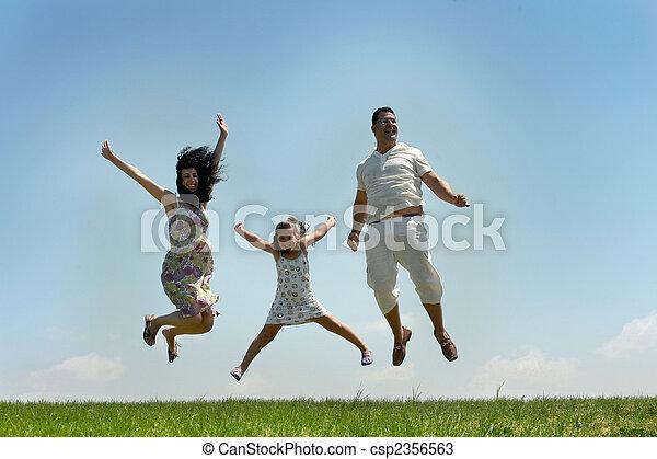 Fly happy family on blue sky - csp2356563