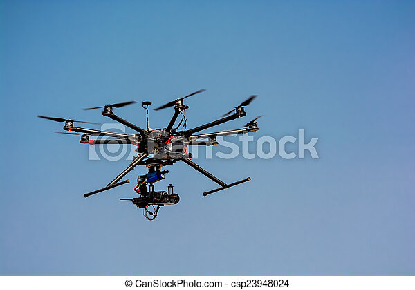 flying drone with a camera - csp23948024