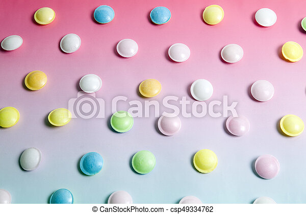 flying saucer multi coloured candy - csp49334762