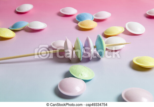 flying saucer multi coloured candy - csp49334754