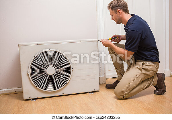 Focused handyman fixing air conditioning - csp24203255