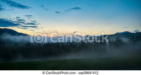 fog in the mountains at sunrise - csp38641412