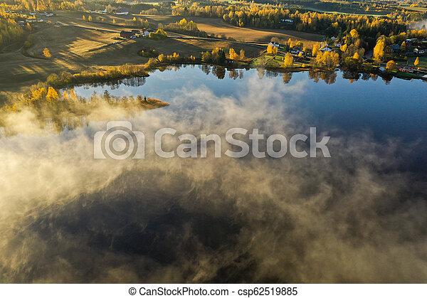 Fog on lake in Autumn - csp62519885