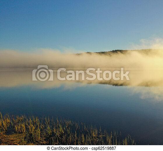 Fog on lake in Autumn - csp62519887