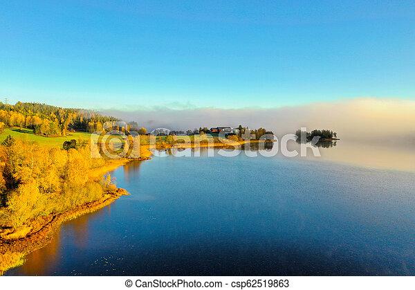 Fog on lake in Autumn - csp62519863