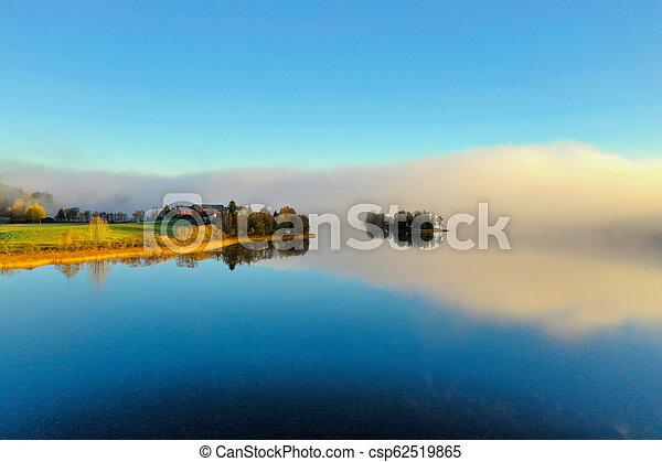 Fog on lake in Autumn - csp62519865