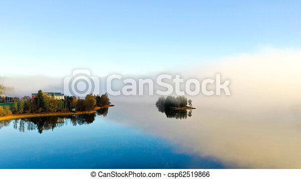 Fog on lake in Autumn - csp62519866