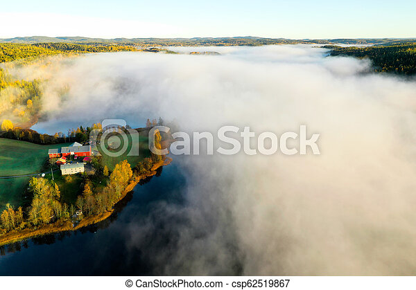 Fog on lake in Autumn - csp62519867
