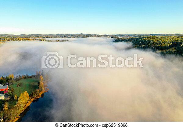 Fog on lake in Autumn - csp62519868