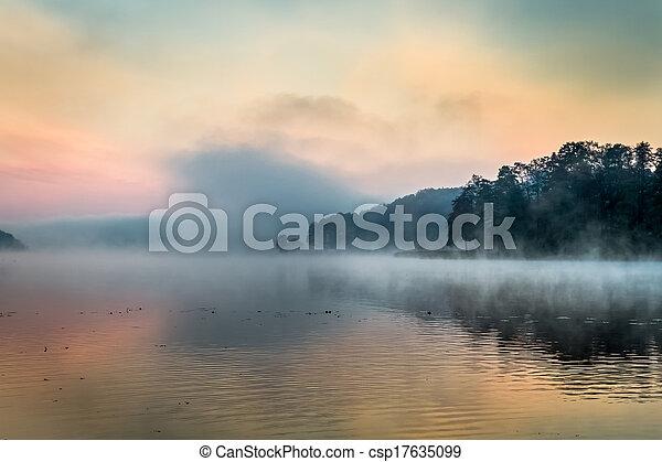 Fog over the lake at sunrise - csp17635099