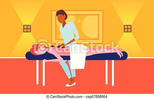 fogalom, megkövez, nő, türelmes, hosszúság, masszőz, hotel, fiatal, masszázs, hagyományos, csípős, tele, egészség, amerikai, afrikai, ásványvízforrás, horizontális, élvez, leány, masszázs - csp67858954