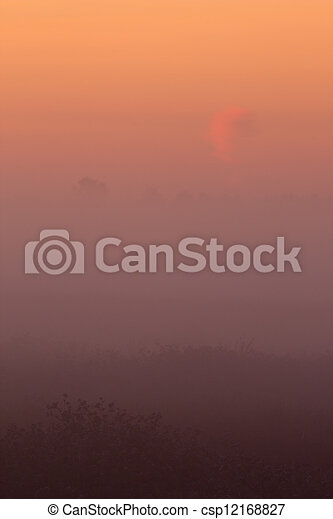 Foggy magical sunrise - csp12168827
