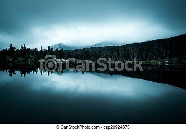 Foggy morning on a Lake - csp20924873