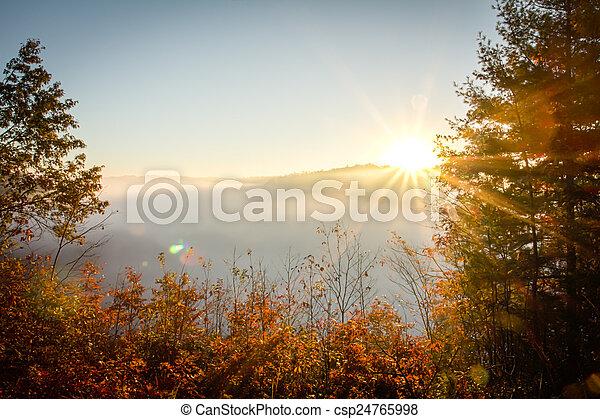 Foggy Morning Sunrise - csp24765998